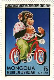 Stamp with monkey on tricycle