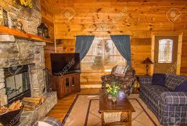 interior of log cabin with stone fireplace and seating area stock photo 35933648