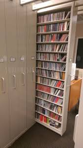 high density pull out shelves for media storage