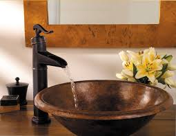 rustic bowl sink with water pump faucet