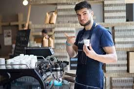 Barista making coffee with waiter. Barista Stories Tomas Laca Of Coffee Source Prague European Coffee Trip