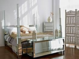 mirrored bedroom furniture cheap white grey colors covered bedding sheets dark furniture near glass window white wooden inexpensive nightstand lamp wooden bedside table minimalist interior decoration