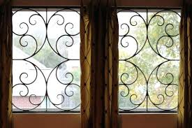 decorative faux wrought iron window insert by inserts rod covering designs