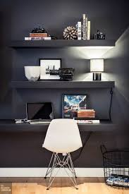 Floating shelf desk Wall Mounted Black Wall With Floating Shelves And Desk With Displays And Much Light 11evergreeninfo 27 Awesome Floating Desks For Your Home Office Digsdigs