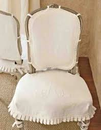 how to cover up a not so good looking upholstery on a very nice french dining chair you can do a simple tie for each leg the excess wrapping is not