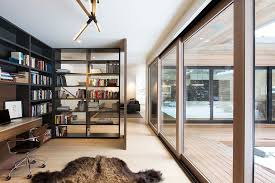 home office space design. Open Bookshelf Adds As A Divider Between The Home Office And Living Room [ Design: Space Design 2