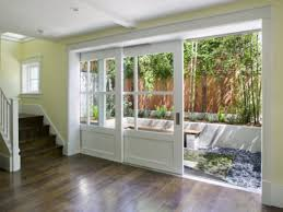 sliding glass doors be an option to design house can be apply sliding patio doors with wood frame screen door and panel glass