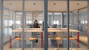 interior design office space. Glass Conference Room In Middle Of Office Space With Stools Interior Design