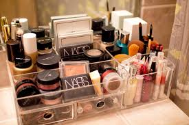 pact makeup organizing idea with acrylic storage desgn with plots and some makeup tools