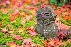Stone Little Monk Sculpture With Colourful Maple In Enkoji Temple Kyoto  Japan In Autumn High-Res Stock Photo - Getty Images
