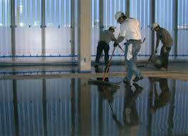 workers installed ultratop in natural gray from mapei as flooring at the anchorage museum in anchorage