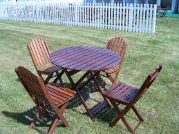 wooden table with 4 chairs parasol base hired as a set