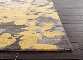 gray and yellow area rug