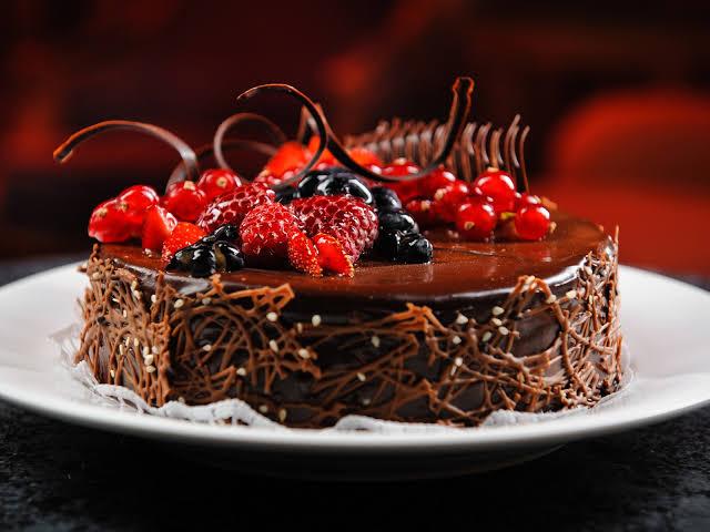 happy birthday chocolate cake with strawberries