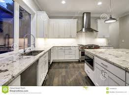 Large Spacious Kitchen Design With White Kitchen Cabinets Stock
