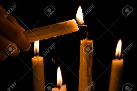 Lighting Candles Hands Light Up The Candles With Another Candle