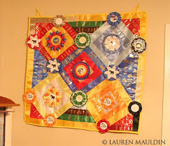 How to make an Equestrian Ribbon Quilt | She Moved to Texas & ... the quilt where I wanted them. I put one in every square, and then at  every corner of a square… but you can do as many or as little as you want. Adamdwight.com