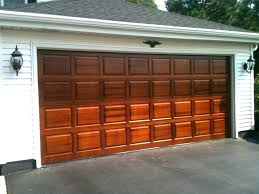 wood stained garage doors wood stained garage doors classic collection raised panel wood garage door in wood stained garage doors