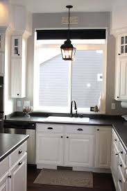 kitchen decor above kitchen sink lighting ideas using candle shaped led bulbs inside pendant lantern light fixtures also