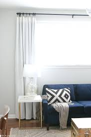 how to hang curtains to transform your windows the playbook curtains for wide windows adjusting the long curtains curtains for long wide windows
