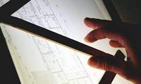 an architect to draw up plans