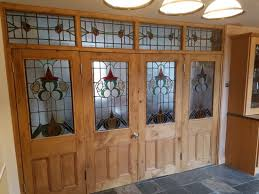 stunning stained glass bifold srt with transom frame curly