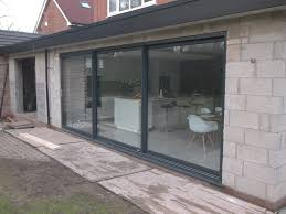 large aluminium dutemann sliding door installed on an orangery greasby wirral