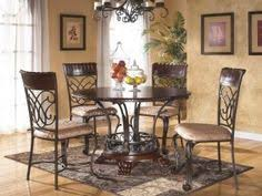 dining room small round dining table ideas ashley furniture small round dining room table sets with decorative rugs on laminate wood floors as well as