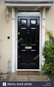 A black front door to a regency style house Stock Photo: 57906724 ...