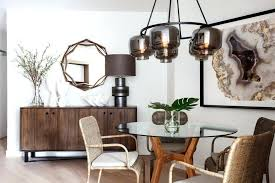 mirror over buffet in dining room buffet table sideboard dining room contemporary with warm neutral colors round glass dining table brown glass mirror over