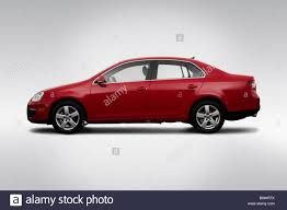 volkswagen jetta 2009 red. 2009 volkswagen jetta se in red - drivers side profile