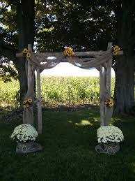 diy summer country rustic wedding arch sunflower and burlap decor made from fence rails