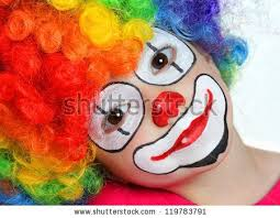 happy clown face painting for kids pretty with face painting of a clown stock photo 119783791