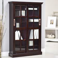 brown varnished walnut bookcase with glass doors