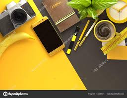 office desktop view with business objects in yellow stock photo