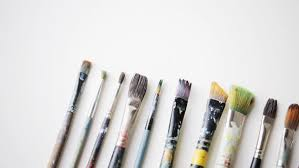 art creativity and tools concept messy palette knives and paintbrushes hd stock video