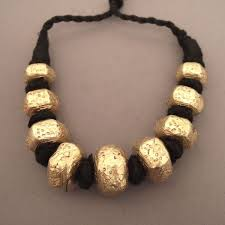 22ct gold afghan necklace on pitch resin made up of 9 beads with geometrical