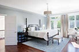 This Bright Bedroom Features High Contrast Between Dark Wood Flooring And Sky Blue Walls Area
