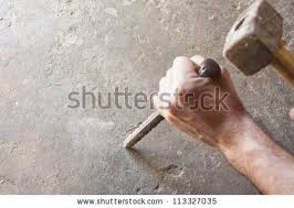ancient stone chisel. bricklayer tools men working ,construction background ancient stone chisel
