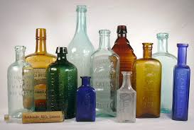 group of medicinal bottles dating from the 1860s to 1920s to enlarge the antique bottle glass