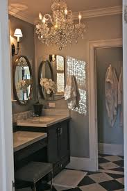 View gallery bathroom lighting 13 Masculine Widely Used Mirror Chandelier Inside Elegant Retreat oval Mirror Framed In Cherry Losangeleseventplanninginfo View Gallery Of Mirror Chandelier showing 13 Of 20 Photos