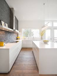 simple white kitchen. inspiration for a modern kitchen remodel in portland with flat-panel cabinets, white cabinets simple u