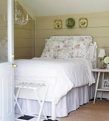 guest bedroom with pink floral bedding chandelier barn board