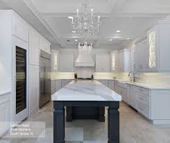 White Kitchen Cabinets With A Dark Grey Island Omega