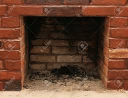 backdrop of a brick fireplace wall in a vacant setting stock photo