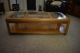 wood and glass coffee table with shelf underneath