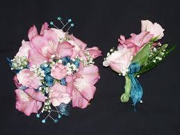 pink alstroemeria pink spray roses with baby s breath and blue accents with blue ribbon wrist wrist corsagespray