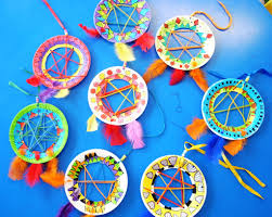 DREAM CATCHERS These Native American dream catchers are really popular with  kids. Buy small paper plates and cut out the middles with a craft knife.