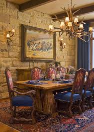 stone wall and antler lighting for the rustic dining room design rick o