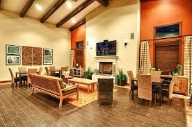 burnt orange and brown living room. Luxury Brown And Orange Living Room For Tropical With High Ceiling Exposed Beam Cement Burnt